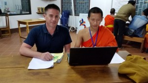 Helping a novice monk student in my class.