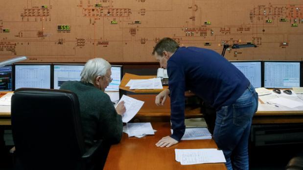 Dispatchers work in the control room of Ukraine's National power company Ukrenergo, in Kiev. Ukraine has been hit ...